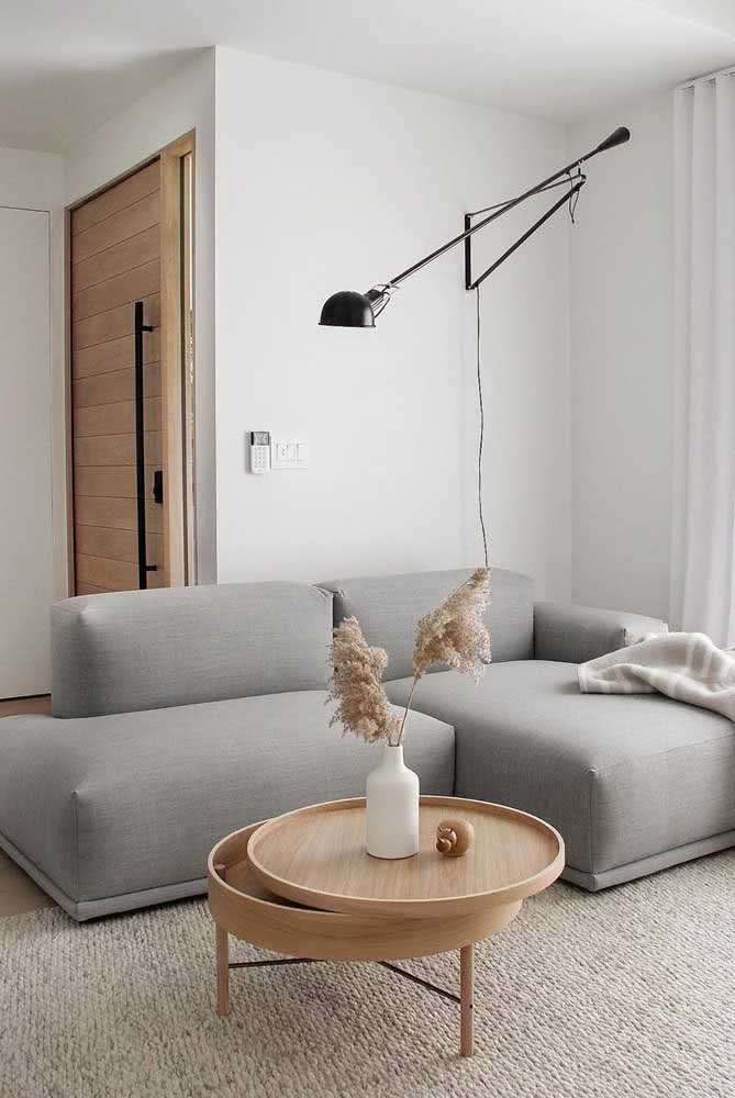 Retractable gray sofa for small room functionality, comfort and aesthetics in the same furniture.