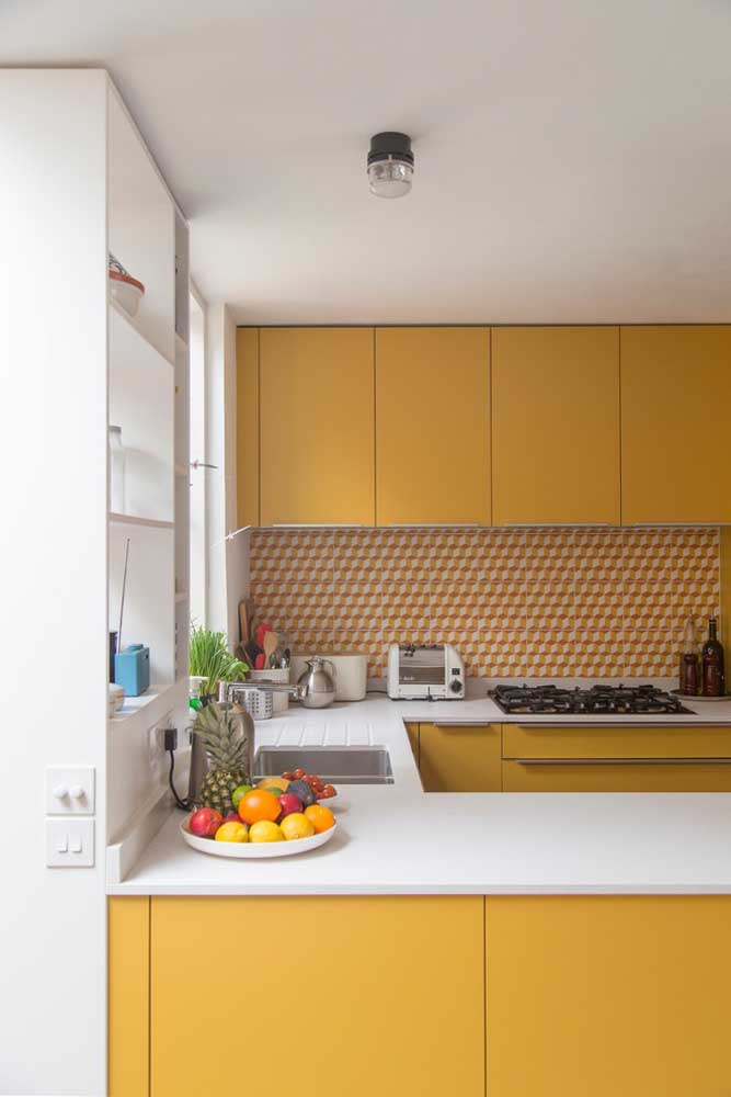 11. A charm in this small American kitchen with yellow and white furniture.