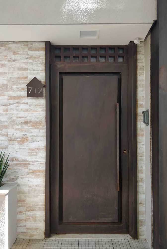 16. How about placing a corten steel door at the entrance to the house?