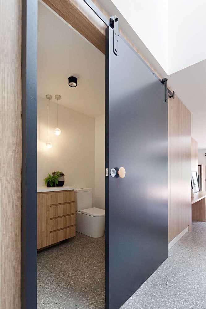 39 - The beautiful contrast between the wooden handle and the black door.