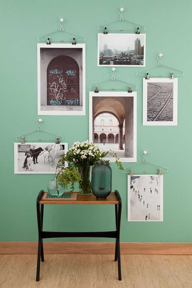 19. Want to make a totally different photo panel?Place some hangers on the wall and attach pictures to each one.