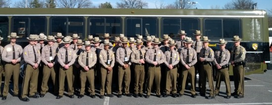 When a busload of troopers stops a DUI driver, how do they decide which one has to make the arrest?