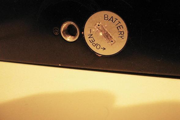 tampa de bateria de câmera analógica