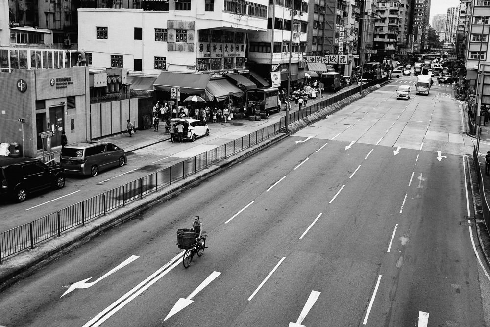Bicycle rider on road in Hong Kong