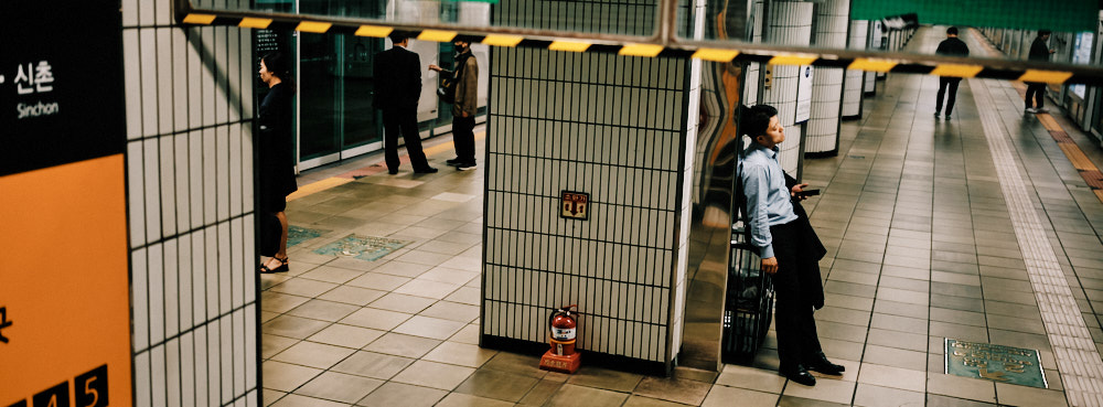A man leans on the subway wall for support after a few too many