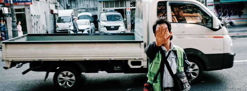 Parking attendant with his hand up