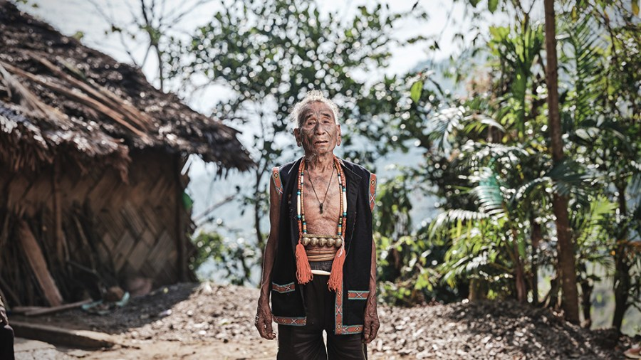 A portrait of a Wancho man