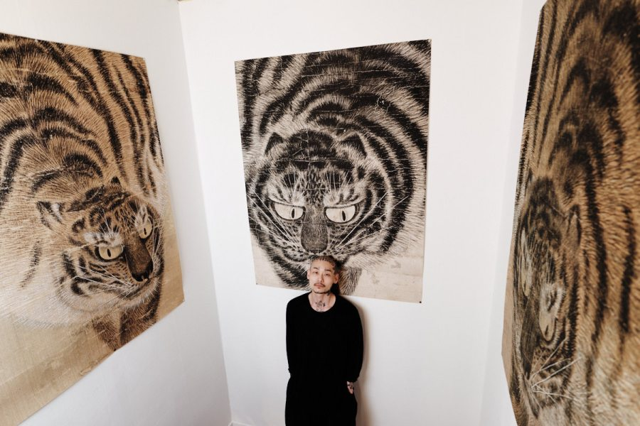 Apro Lee with Tiger Paintings