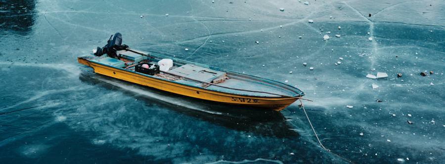 Boat Frozen in River