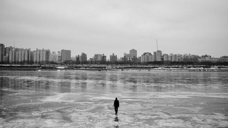 Man Walking on Frozen Han River