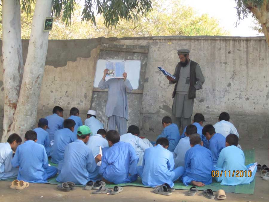 A class being taught outside (courtesy of e-architect).