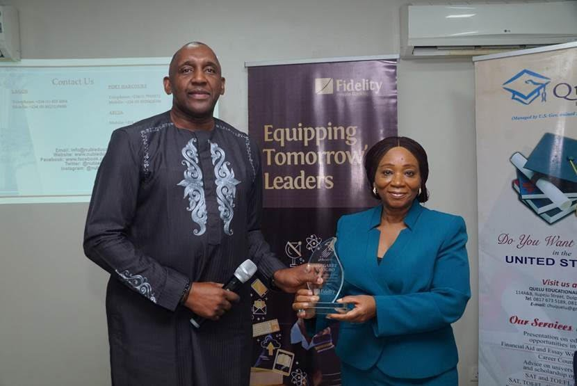 Directorate Head, Corporate Bank, Obaro Odeghe presenting a plaque to the Managing Director, Quelu Konsult, Mrs. Margaret Anyigbo at the recently concluded Fidelity Private Banking Education Advisory Forum in Lagos | e-nigeria! - e-nigeriang.com