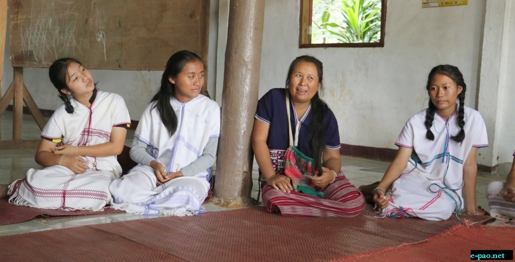 An adept listening of Karen young girls to an elder's sharing on Karen cultures and way of life at Huay E-Khang village, Northern Thailand, 8 September 2016