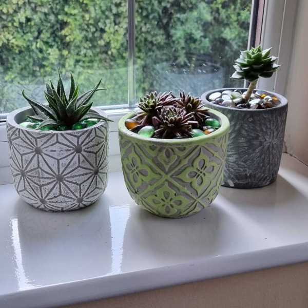 set of pots on window sill