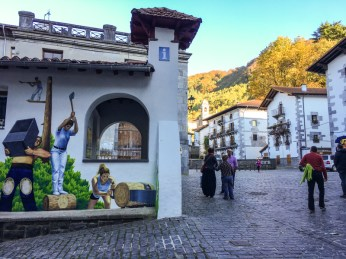 "Town square of Leitza with mural of ""Herri Kirolak """