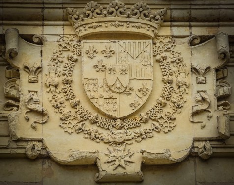 The coat of Arms with it's Fleur-de-lis, that is associated with the French monarchy