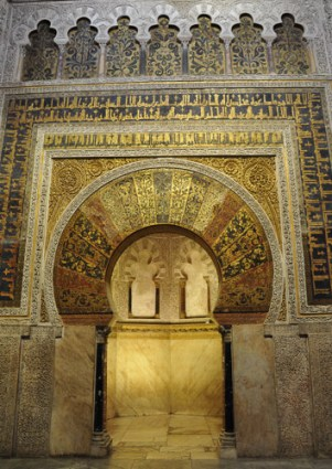 In the qibla or end wall of the building, lies the mihrab or niche for the prayer-leader