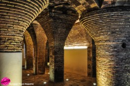 The columns in the basement of Palau Güell is reminiscent of those in Park Güell