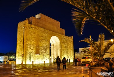Imposing Porta Napoli greets visitors arriving from west