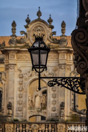 The lanterns match the rich Baroque architecture