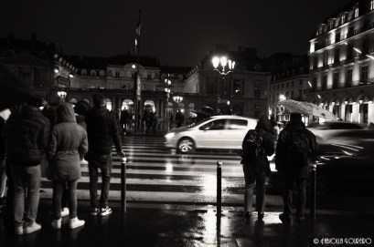 Rainy night in Rue de Rivoli with the Louvre in the background