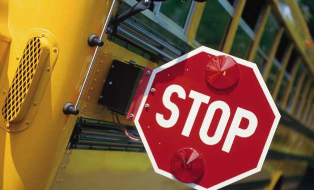 Do drivers know not to pass a stopped school bus?