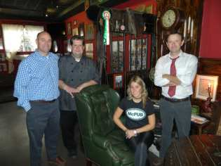 McCarthy's Pub owners, from left, Deege, Ward and Keely O'Hara, and pub host Kevin McCarthy. (photo by Jason Emerson)