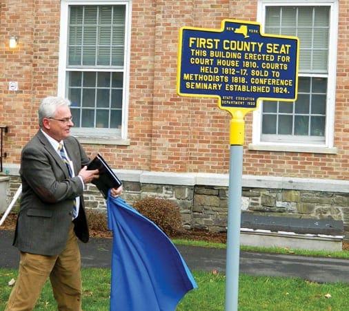Cazenovia College President Ron Chesbrough unveils the marker. )photo by Jason Emerson)