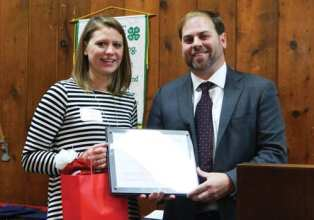 CCE-MC board member Jessica Burch, left, was honored at the organization's Dec. 4 annual meeting for her service to the board. CCE-MC President Cory Mosher gave her a plaque and gift. (photo by Jason Emerson)