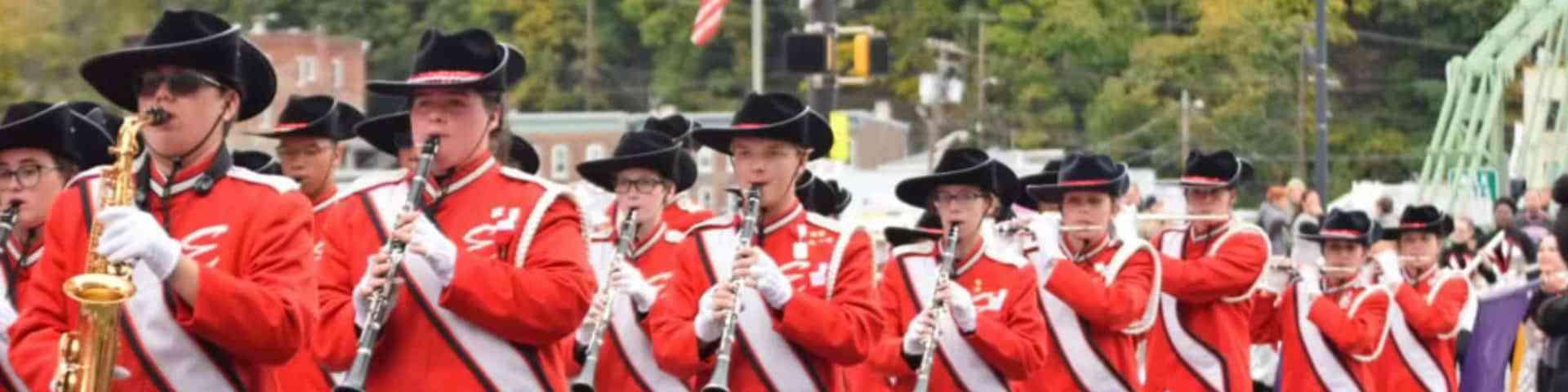 "Band members marching across the Easton ""Free Bridge."""