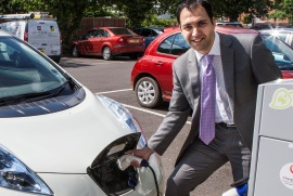 Councillor Bassam Mahfouz using the electric car charging point