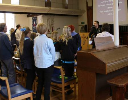 Church service in Earls Colne worship