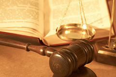 gavel and book near scales