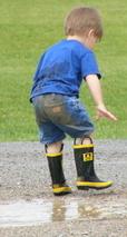 wet muddy boy