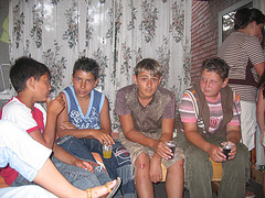 several boys sitting together on porch