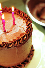 chocolate birthday cake with pink candles