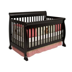 baby crib with pink bedding