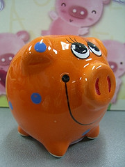orange clay piggy bank with smile