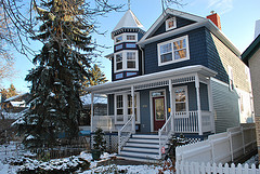 front of two story gray home with white trim