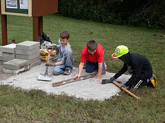 3 boys working on a volunteer playground project