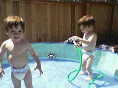 toddlers playing in kiddie pool