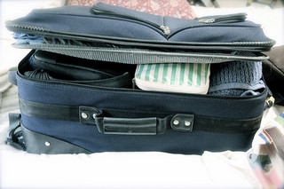 side view of suitcase packed for trip