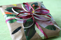 handmade wrapped gift with leaves, floral motif