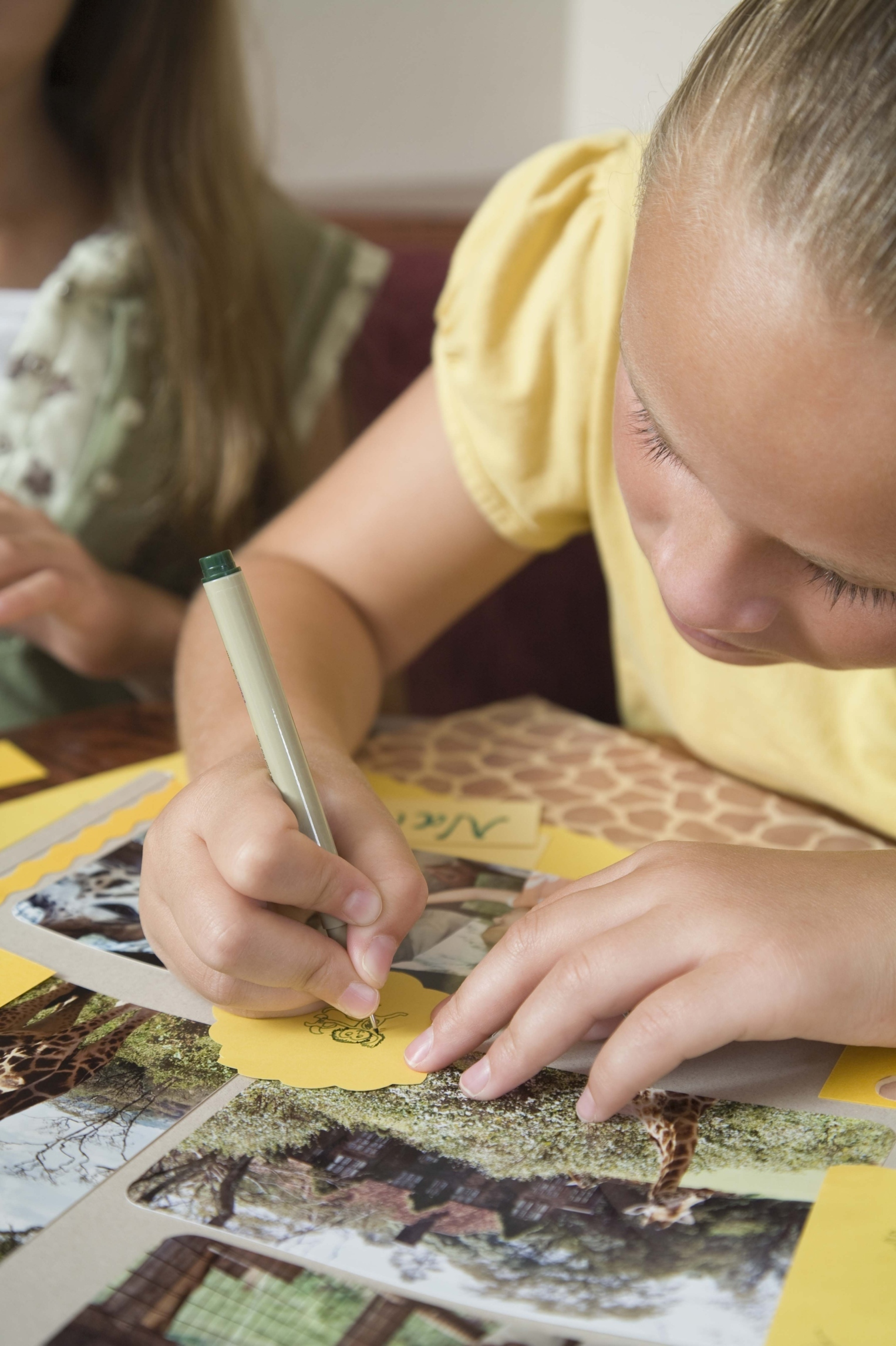 girl working on scrapbook page