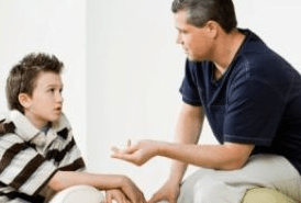 father talking with son seriously