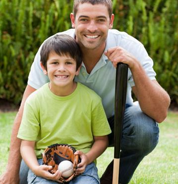 father and son holding baseball, mitt, bad