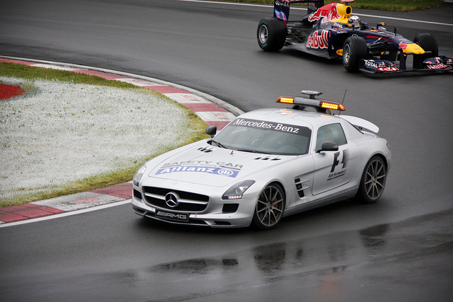 pace car leading the pack on racetrack