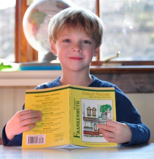 preschool age boy holding book