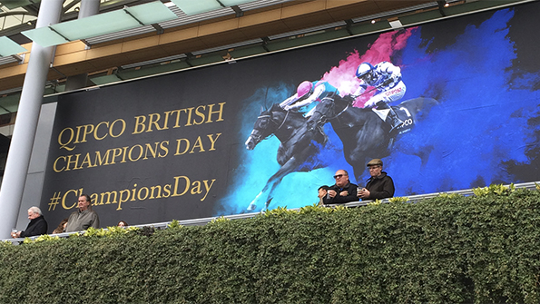 British Champions Day creative poster at Ascot with two horses and jockeys and paint burst effect. Earnie creative design