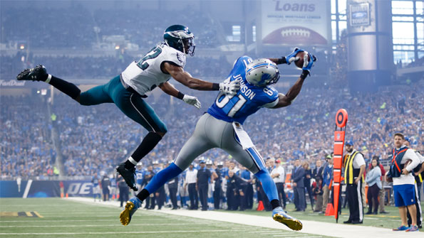 Image of Calvin Johnson catching an american football during a game against the Seahawks. Earnie creative design